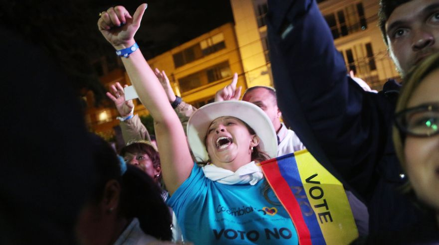 BOGOTA, COLOMBIA - OCTOBER 02: 'No' supporters celebrate at a rally following their victory in the referendum on a peace accord to end the 52-year-old guerrilla war between the FARC and the state on October 2, 2016 in Bogota, Colombia. The guerrilla war is the longest-running armed conflict in the Americas and has left 220,000 dead. The plan called for a disarmament and re-integration of most of the estimated 7,000 FARC fighters. Colombians have voted to reject the peace deal in a very close vote. Mario Tama/Getty Images/AFP == FOR NEWSPAPERS, INTERNET, TELCOS & TELEVISION -- -- USE ONLY ==